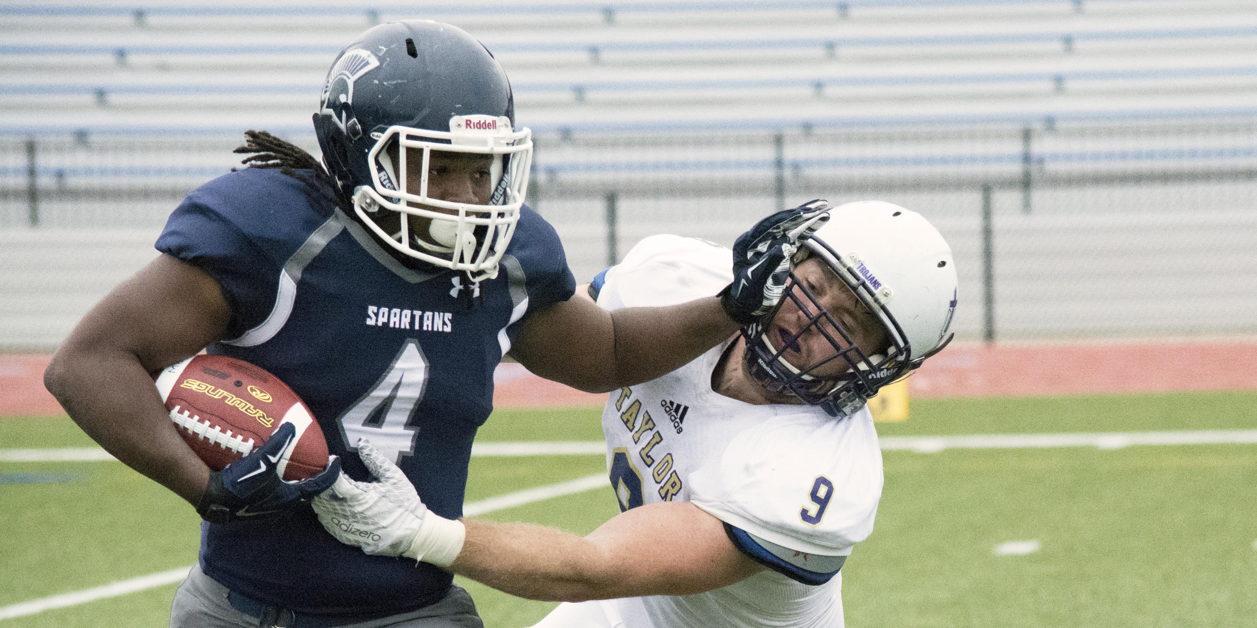 Antoryio Barton stiff-arms the Taylor defender.