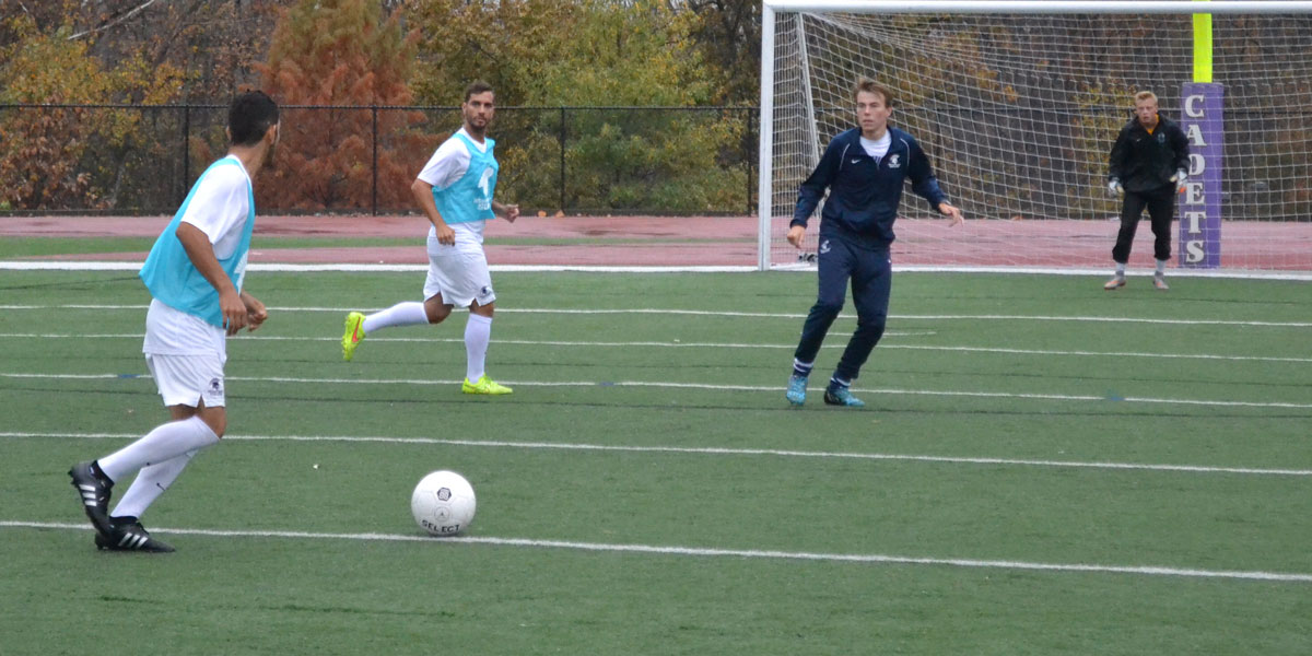 Gerardo Espinoza looking for a teammate to pass the ball to.
