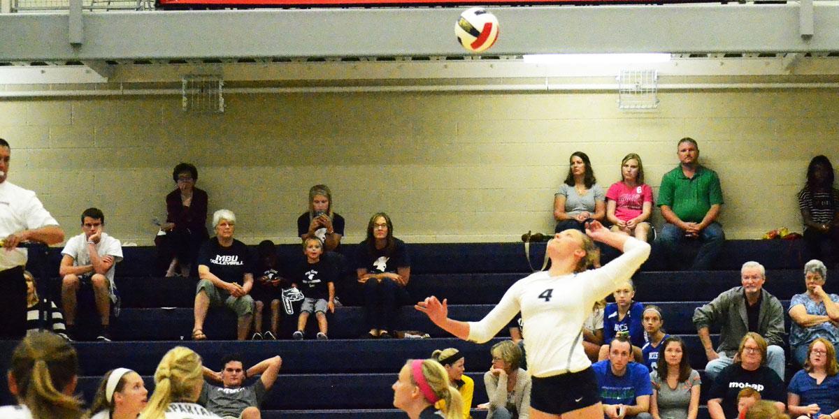 Senior-Hannah-Carey-jumps-to-kill-the-ball